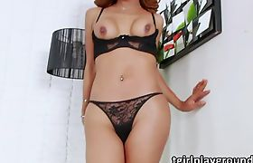 Ladyboy Oil inserts a dildo to her ass as she pleases her lust