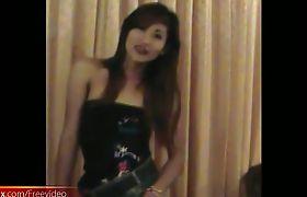 Asian ladyboy lifts her miniskirt and enjoys ass fingering
