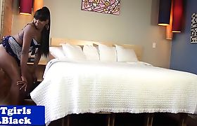 Nubian tgirl inserts huge dildo in ass