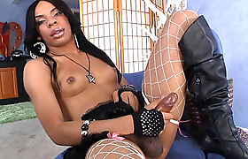 Sexy slender ebony shemale satisfied herself with a toy