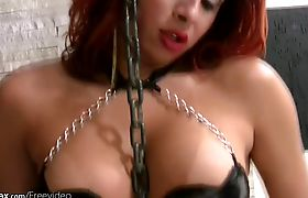 Redhead t-babe strips latex lingerie and reveals massive ass