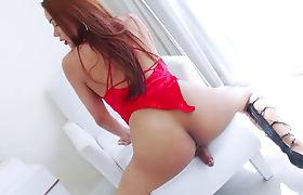 Hot ladyboy Ploy shaking her big booty and masturbating
