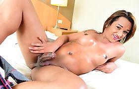Tranny brazilian Tatoo showing her uncut shecock and masturbate it